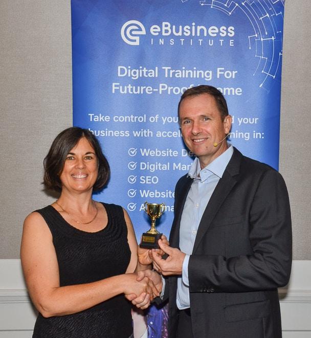 Matt Raad awarding Fiona Herbert with her Excellence Award 2018.